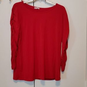 Nice red top with gathered sleeves